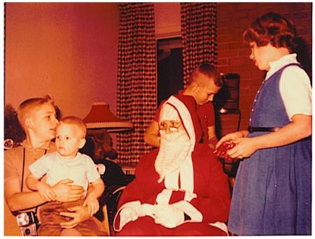 Siblings and santa in color